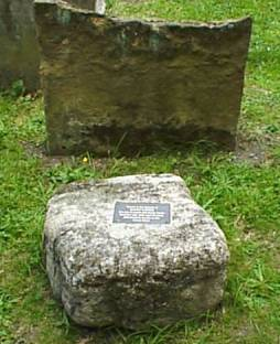 The new stone (loosely modelled on the stone), with behind it the crumbling previous headstone